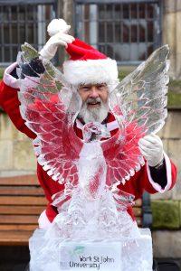 ice sculpture of bird and Santa
